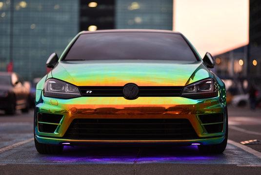 Kiev / Ukraine - 04.10.19: car Golf 7 R is covering film of color iridescent. Car Parking Concept