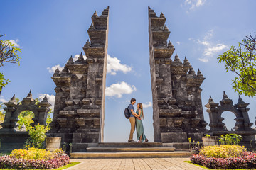 Loving couple of tourists in budhist temple Brahma Vihara Arama Banjar Bali, Indonesia. Honeymoon