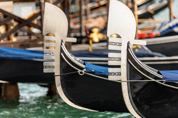 Venice, detail of two gondola prows, typical Venetian rowboat, Canal Grande, UNESCO world heritage site, Veneto, italy, Europe