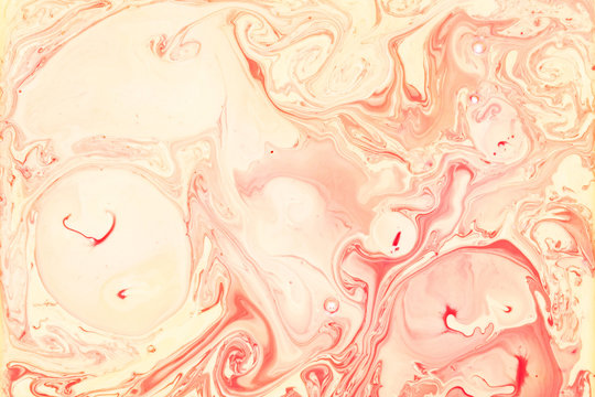 Red and Yellow Fluid Liquid Acrylic Paint Marbled Texture