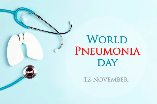World pneumonia day concept with lungs and stethoscope on a blue background.
