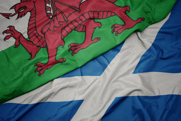 waving colorful flag of scotland and national flag of wales.