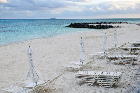 Grand Bahama sandy beach. Seaside view. Tropical beach with white sand and blue water