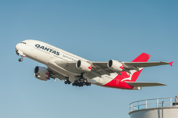 Qantas Airbus A380 departing into a crystal clear blue sky from London, Heathrow, UK - January 28, 2016