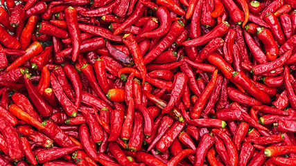 Tuinposter Hot chili peppers Close up group of red hot chilli peppers pattern texture backgr
