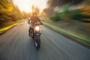Motorcycle driver with blurred motion effect