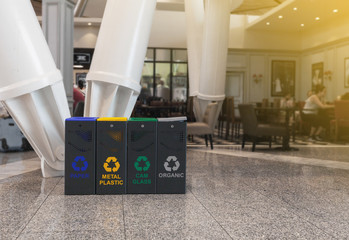 2019-05-15, Marrakech, Morocco. Multi Coloured Garbage Trash Bins. Recycling bins at the airport