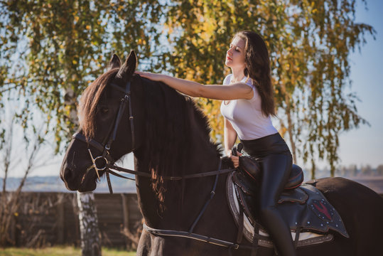 Rider elegant woman talking to her horse. Portrait of riding horse with woman . Equestrian horse with rider at nature