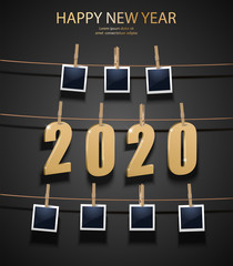 Vector New Year background with golden 3d letters 2020 and photo frames hanging on the memory board.