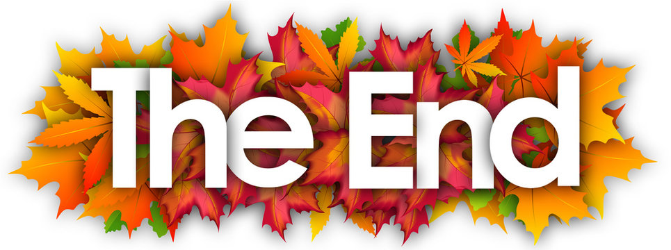 The End word and autumn leaves background
