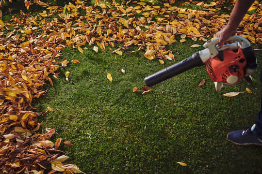 A man working with a leaf blower
