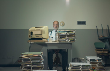 Frustrated businessman overloaded with paperwork