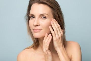 Millennial Caucasian woman touch soft healthy skin
