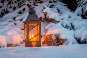 lantern for christmas in the snow