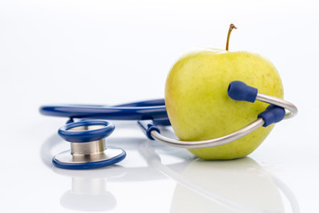 apple and stethoscope on a white background