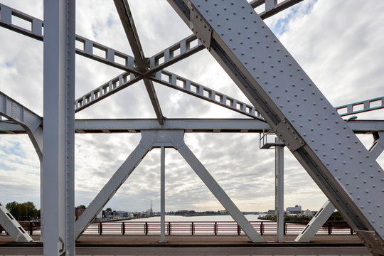 Closeup of a steel bridge frame with rivets