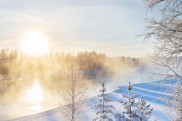 Printed kitchen splashbacks Beige Mist over freezing river on a sunny cold winter day. Trees covered with frost and snow.