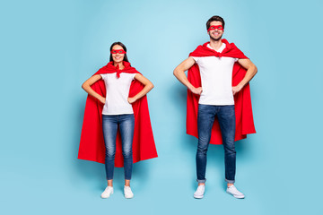 Full length body size view of his he her she nice attractive content cheerful sporty people wearing red superhero look hands on hips isolated on bright vivid shine vibrant blue turquoise background