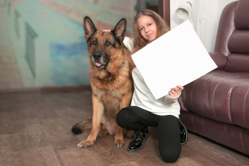 teenage girl showing her drawing depicting her dog