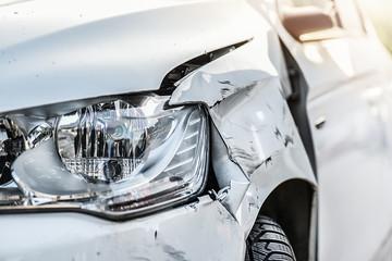 Obraz Car crash or accident. Front fender and light damage and scratchs on bumper. Broken vehicle detail or close up. - fototapety do salonu