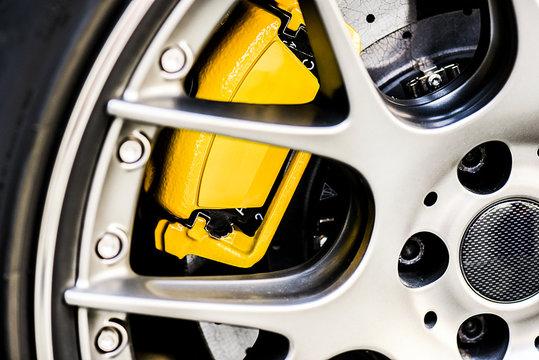 Sport bbs wheel rim close up. Detail of yellow new brake pads changed on luxury car.