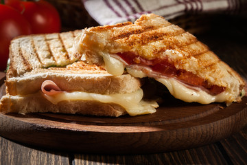 Panini with ham, cheese and lettuce sandwich