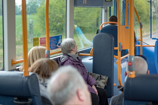 Park and ride bus interior, showing seated passengers travelling to Cambridge city centre. Passing through open countryside, as seen from outside the windows.