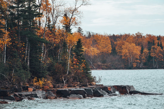 Apostle Islands National Lakeshore along Lake Superior in Wisconsin during fall color season on overcast day in Autumn