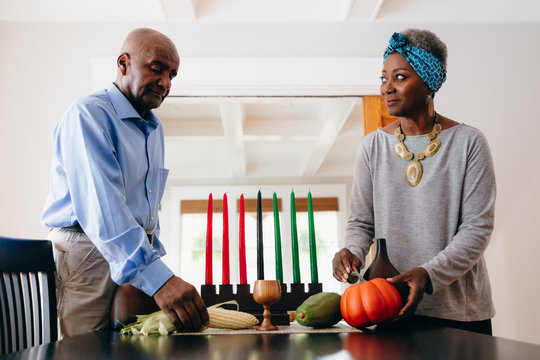 Grandparents arranging Kwanzaa set