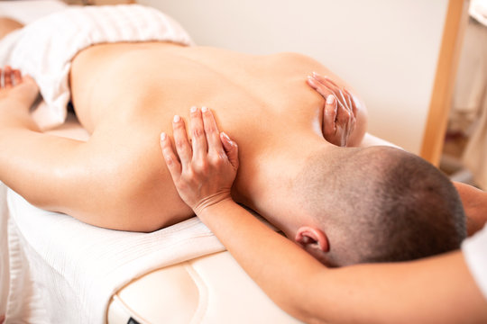 Relaxing massage for a muscular young man
