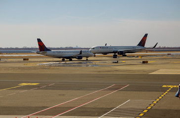 Delta Airlines jet planes, airport terminal gates Servicing F. Kennedy International Airport. Delta Airlines