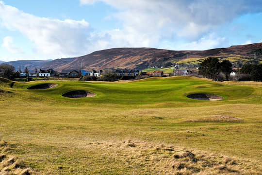 Approach to the 6th green on Brora Golf Course showing the bunkers