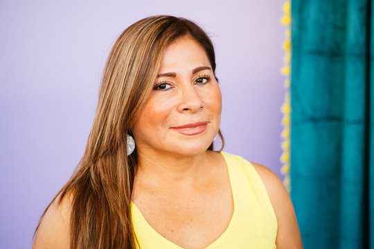 Portrait of Latina woman/mother in studio environment