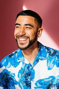 Portrait of Latino gay man in studio environment