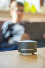 Keuken foto achterwand Boeddha Smart ai speaker with child playing on tablet in the backround. Smart home concept