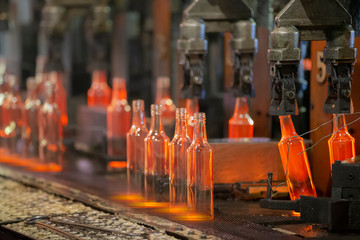 Glassworks. Glass industry. The process of making glass bottles.