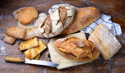 Assorted bread on wood background. Top view