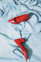 Red heel shoes placed on cloth