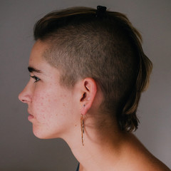 Profile of woman with shaved side hairstyle