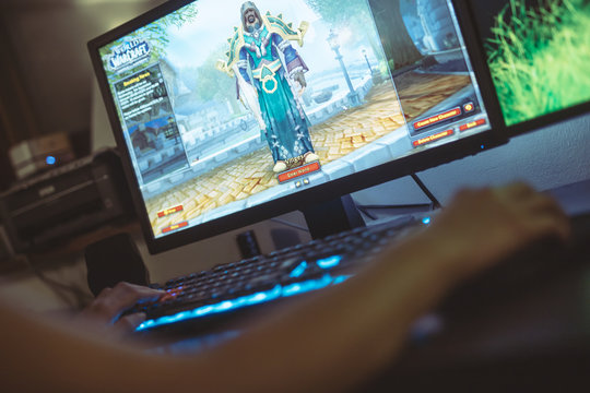 WROCLAW, POLAND -  SEPTEMBER 04th, 2018: Woman playing World of Warcraft: Battle of Azeroth game. WoW is a massively multiplayer online role-playing game (MMORPG) released in 2004