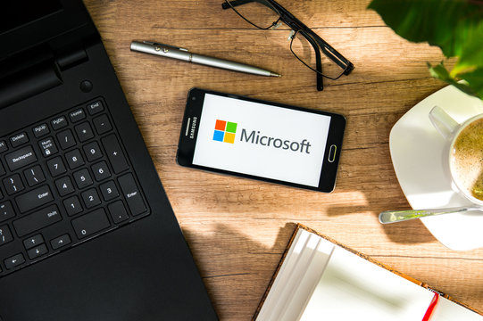 WROCLAW, POLAND - NOVEMBER 17th, 2017: Samsung A5 is laying on the desk with Microsoft logo on screen. Microsoft Corporation is an American multinational technology company