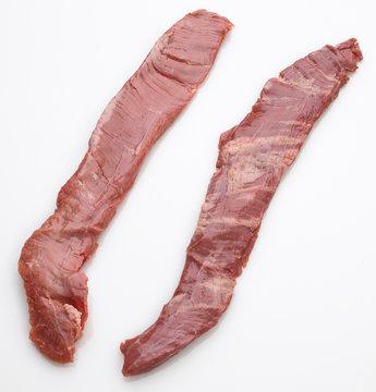 2 raw marbled beef skirt steaks overhead view