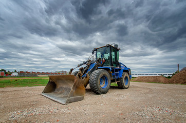 Blue Wheel loader on a construction site, mining
