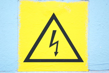 Picture of dilapidated sign Caution high voltage