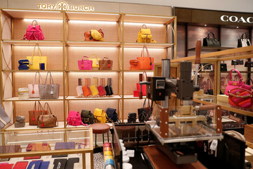 Designers Tory Burch and Coach bags are seen on display at the Nordstrom flagship store is seen during a media preview in New York