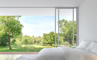 Minimal style bedroom with nature view 3d render.The pure white room decorate with white fabric bed,There are large open sliding doors, Overlooks wooden terrace and big garden.