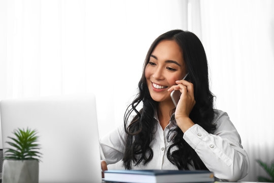 Young Asian woman working in office