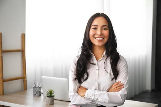 Beautiful Asian woman in office