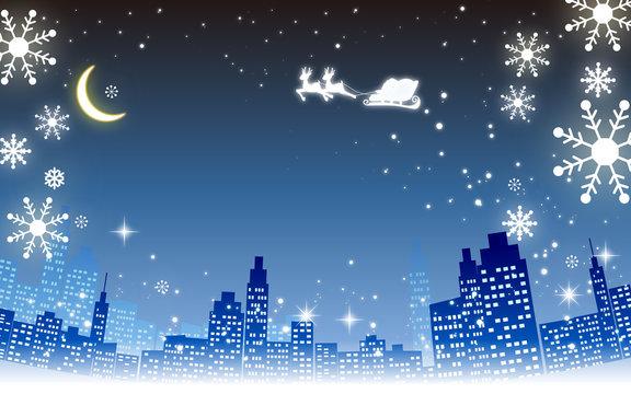 クリスマスイメージ素材・都市夜景とプレゼントを運ぶサンタとトナカイシルエット・雪の結晶