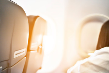Inside the plane, in the window area, the sunlight shines.